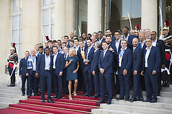 French President Emmanuel Macron, his wife Brigitte Macron, head coach Didier Deschamps, captain and goalkeeper Hugo Lloris, holding the trophy, and teammates pose for a pictures during a reception at the Elysee Presidential Palace on July 16, 2018 in Paris, France, after French players won the Russia 2018 World Cup final football match. France celebrated their second World Cup win 20 years after their maiden triumph on July 15, 2018, overcoming a passionate Croatia side 4-2 in one of the most gripping finals in recent history. Photo by Eliot Blondet/ABACAPRESS.COM