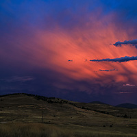 A thunderstorm with mammutus formations colors the sunset over the Rattlesnake Wilderness near Missoula.