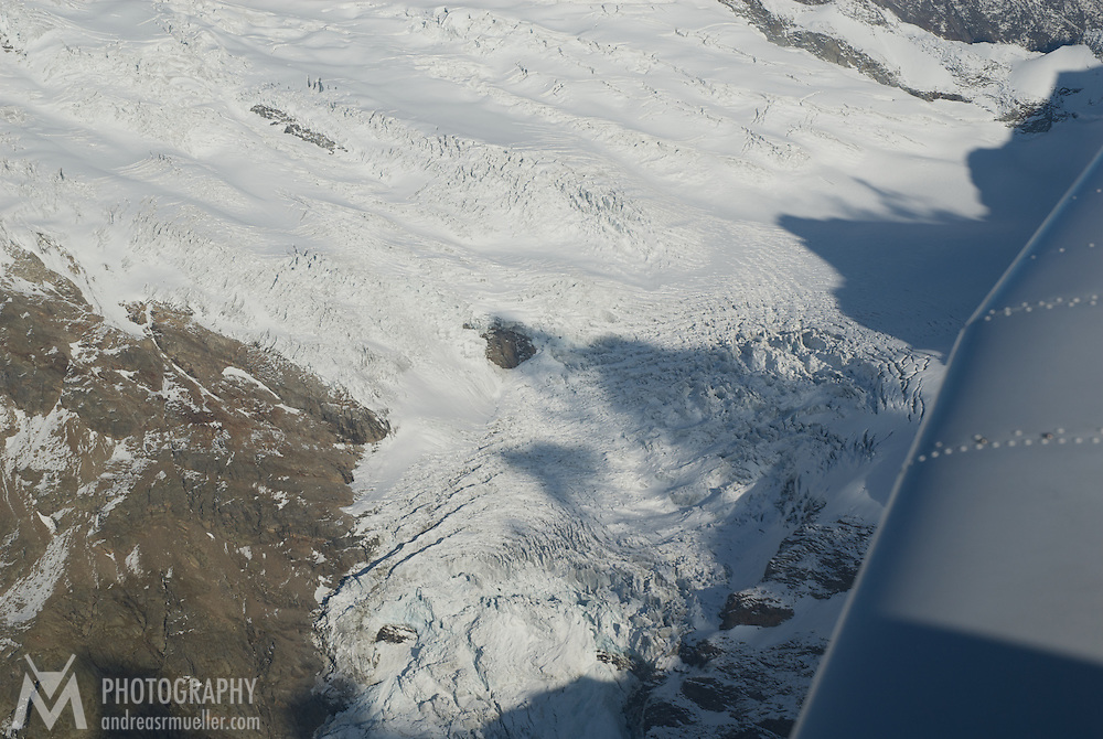 Aerial view over dramatically structured glaciers in the Swiss alps.