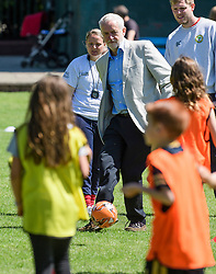 © Licensed to London News Pictures. 10/06/2017. London, UK. Leader of the Labour Party JEREMY CORBYN kicks a ball while visiting a local children's football match at a council park in his constituency. The Labour party made significant gains earlier this week in a general election The Conservative Party were expected to win comfortably. Photo credit: Ben Cawthra/LNP