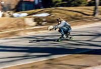 Bill Marlowe skateboarding down Front Street, Marquette, MI, 1981