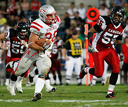 11.07.2011, UPC Arena, Graz, AUT, American Football WM 2011, Group B, Kanada (CAN) vs Oesterreich (AUT), im Bild Christoph Putz (Austria, #28, DB) running with the ball beeing followed by Steve Faoro (Canada, #50, LB) and Peter Carriere (Canada, #55, LB)// during the American Football World Championship 2011 Group B game, Canada vs Austria, at UPC Arena, Graz, 2011-07-11, EXPA Pictures © 2011, PhotoCredit: EXPA/ E. Scheriau