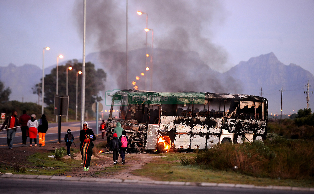 South Africa - Cape Town - 15 July 2020 - A bus was petrol bombed during the ongoing violent housing  protest on old faure road in Mfuleni Bosasaroad between Spine road and Mew Way in Eersterivier was closed. Photographer Ayanda Ndamane African News Agency (ANA)