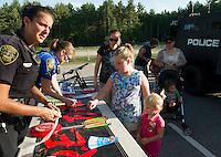 Bella and Hannah Chaignot with Dare Officer Michelle Cardinal and Officer Kathleen Yale at Laconia's National Night Out Tuesday evening at Woodland Heights School.   (Karen Bobotas/for the Laconia Daily Sun)