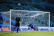 Crewe Alexandra goalkeeper Dave Richards (13) sees the penalty taken by Gillingham FC midfielder Jordan Graham (10) fly past him and into the net during the EFL Sky Bet League 1 match between Gillingham and Crewe Alexandra at the MEMS Priestfield Stadium, Gillingham, England on 26 January 2021.