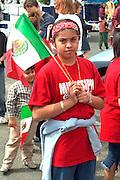 Cinco de Mayo parade participant age 12 Mexican Flag.  St Paul Minnesota USA