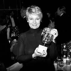 Judi Dench, with her Bafta TV award for Best Actress for 'A Fine Romance', at the British Academy of Film and TV Arts Awards