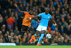 Wolverhampton Wanderers' Bright Enobakhare (left) and Manchester City's Eliaquim Mangala battle for the ball during the Carabao Cup, Fourth Round match at the Etihad Stadium, Manchester.