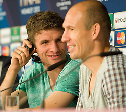 14.05.2013, Allianz Arena, Muenchen, GER, UEFA CL, FC Bayern Muenchen, Medientag, im Bild Thomas MUELLER (FC Bayern Muenchen) und Arjen ROBBEN (FC Bayern Muenchen) gut gelaunt bei der Pressekonefernz // during the open media day of FC Bayern Munich in front of the UEFA Champions League Final 2013 held at the Alianz Arena, Munich, Germany on 2013/05/14. EXPA Pictures © 2013, PhotoCredit: EXPA/ Eibner/ Wolfgang Stuetzle..***** ATTENTION - OUT OF GER *****