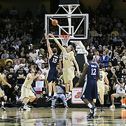 Trey Stanton (15) throws up a shot past Central Florida center Tom Herzog (41) during the first half of  a Conference USA NCAA basketball game between the Rice Owls and the Central Florida Knights at the UCF Arena on January 22, 2011 in Orlando, Florida. Rice won the game 57-50 and extended the Knights losing streak to 4 games.  (AP Photo/Alex Menendez)
