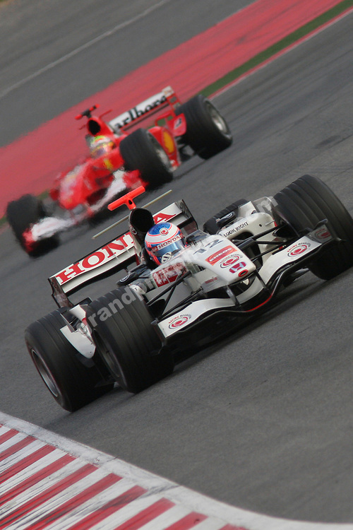 Jenson Button (Honda) leading Felipe Massa (Ferrari) during 2006 pre-season testing at the Circuit de Catalunya outside Barcelona (Spain). Photo: Grand Prix Photo