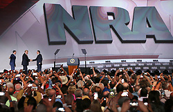 April 28, 2017 - Atlanta, Georgia, U.S.- Thousands of NRA members snap photos as Executive Director of the NRA Wayne LaPierre, right, and Executive Director of the NRA Institute for Legislative Action Chris Cox introduce President Donald J. Trump for his keynote at the NRA-ILA Leadership Forum on Friday. (Credit Image: © Curtis Compton/TNS via ZUMA Wire)