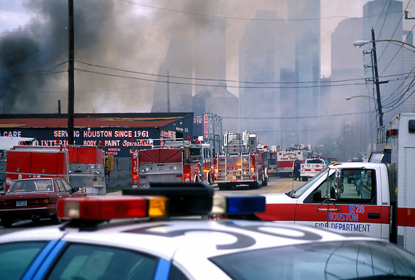 Stock photo of Houston Fire Department trucks blocking the road near downtown as they extinguish a fire