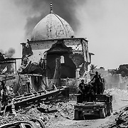 July 2, 2017 -- ISOF troops position themselves amidst rubble near Al-Nuri Mosque days after the Iraqi government declared the Islamic State was defeated in Mosul, while heavy fighting persisted as newly liberated residents still fled the Old City neighborhood in droves.