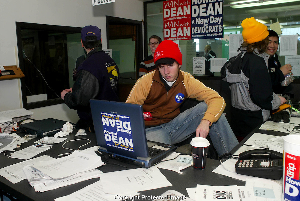 A 12.8 MG IMAGE OF:..A Dean for President volunteer checks the latest polls in the Dean Des Moines headquarters on the day of the Iowa Caucus. Photo by Dennis Brack
