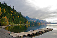 The Fall colours of Maple leaves are reflected in Cultus Lake in Cultus Lake Provincial Park