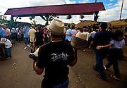 Vendor selling hats during the Maricao Coffee Festivals in the highlands of Puerto Rico