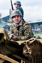 Member of the 1 Fallschirmjäger Division Green Devils living History Group take part in the first days battle re-enactment at Fort Paull. A reenactor looks for enemy threats after forcing the US 82nd to retreat from an ambush<br /> <br />   03 May 2015<br />   Image © Paul David Drabble <br />   www.pauldaviddrabble.co.uk