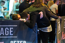 """© Licensed to London News Pictures . 24/12/2016 . Manchester , UK . A man helps another , outside the Birdcage on Withy Grove . Revellers out in Manchester City Centre overnight during 2016's second """" Mad Friday """" , named for historically being one of the busiest nights of the year for the emergency services in the UK . Photo credit : Joel Goodman/LNP"""