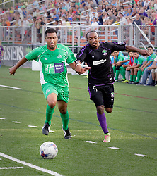 13 June 2015. New Orleans, Louisiana.<br /> National Premier Soccer League. NPSL. <br /> The New Orleans Jesters play against Texas' Premier Soccer League's (TPSL) runner-up, Houston Hurricanes at home in the Pan American Stadium. Jesters take a 3-1 victory at the final whistle. <br /> Photo; Charlie Varley/varleypix.com