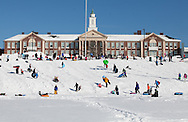 Needham, MA 02/10/2013<br /> A large crowd of sledders fills the field behind Needham High School on Sunday afternoon.