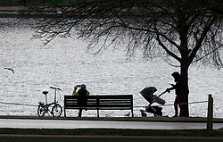 © Licensed to London News Pictures. 11/01/2021. London, UK. Members of the public relax in Hyde Hyde Park in central London during a third lockdown, aimed at controlling the spread of COVID-19. Government is weighing up introducing stricter lockdown measures which would further restrict how often members of the public could leave home. Photo credit: Ben Cawthra/LNP