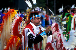 American Indian Man in Costume Fixing Costume of Another Person