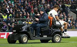 England's Anthony Watson goes off injured during the NatWest 6 Nations match at Twickenham Stadium, London.