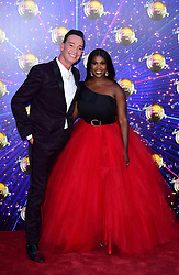Craig Revel Horwood and Motsi Mabuse arriving at the red carpet launch of Strictly Come Dancing 2019, held at BBC TV Centre in London, UK.
