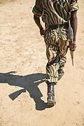 National Park guard walking on sand, South Luangwa National Park, Zambia