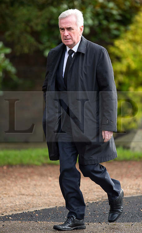 © Licensed to London News Pictures. 13/11/2015. London, UK.  Labour shadow chancellor JOHN MCDONNELL arriving for The funeral of former Labour MP Michael Meacher at St Mary's Church in Wimbledon, south west London.  Michael Meacher, who was a Labour MP in Oldham for over 40 years, served as Minister of State for the Environment in the Tony Blair government.  Photo credit: Ben Cawthra/LNP