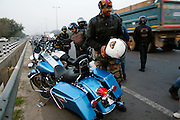 A group of bikers with their motorbikes photographed in India