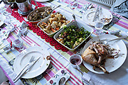 A table of food leftovers, the remnants of Christmas excess on Christmas Day, on 25th December 2020 in London, England. Christmas lunch or dinner in the UK is the main meal during the December Christian celebration, when families traditionally come together for the high-protein turkey and high-fibre vegetables - one of the most nutritious meals of the year.