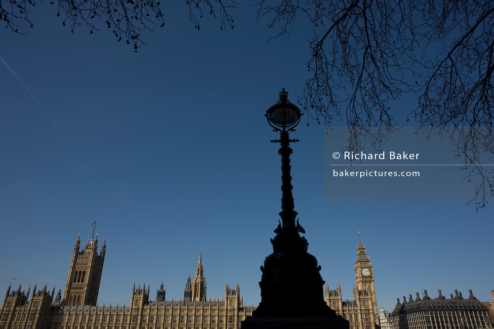 The tower containing Big Ben amid the Gothic architecture of Britain's Houses of Parliament seen from the Embankment