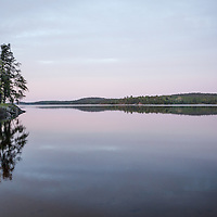 Jackfish Bay in the Boundary Waters Canoe Area Wilderness (BWCAW) in Minnesota. The BWCAW is part of Superior National Forest and is under the administration of the U.S. Forest Service. The wilderness area receives about 250,000 visitors each year and is one of the nation's most visited wilderness areas.