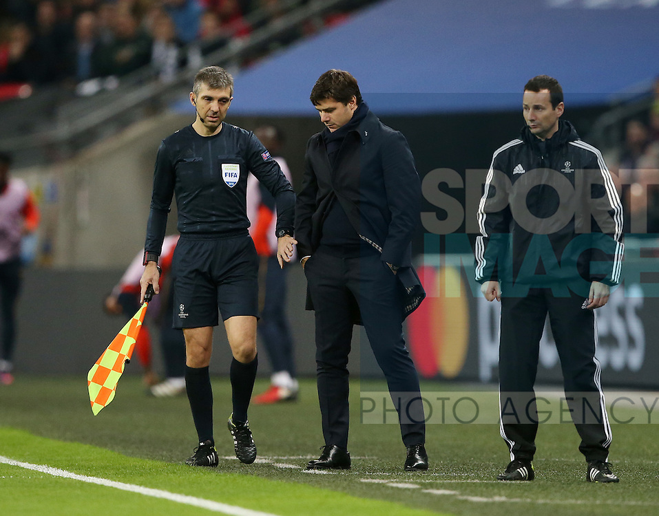 Tottenham's Mauricio Pochettino gets moved out of the way by the linesman despite being in his technichal area during the Champions League group match at Wembley Stadium, London. Picture date December 7th, 2016 Pic David Klein/Sportimage