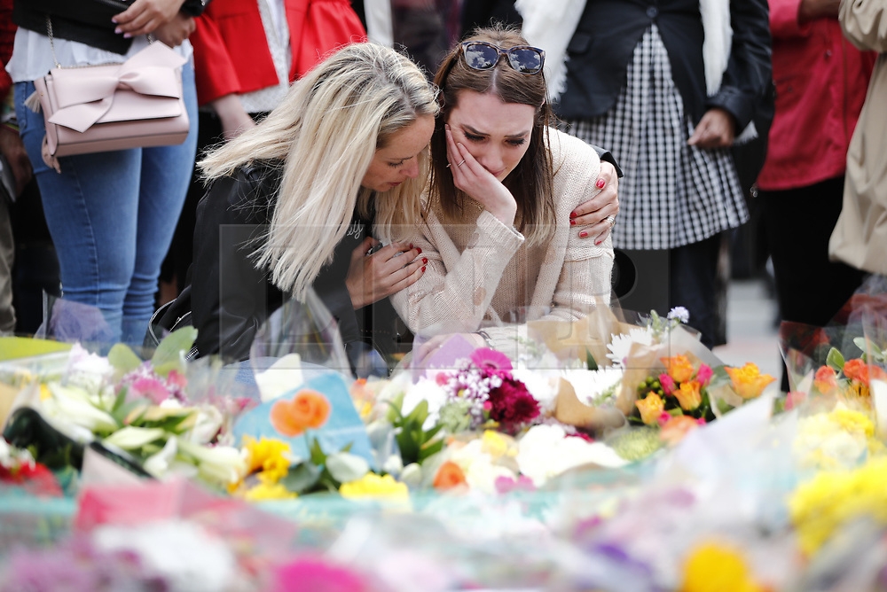 © Licensed to London News Pictures. 07/06/2017. London, UK. People leave flowers for the victims after Saturday night's terror attack that killed 8 people on London Bridge and at Borough Market in central London. Photo credit: Tolga Akmen/LNP