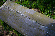 The tombstone of Captain John Lucie Blackman, an officer of the Coldstream Guards, killed by a French bullet in Hougoumont Farm, at the very end of the Battle of Waterloo, on 25th March 2017, at Waterloo, Belgium. The farm became an epicentre of fighting in the Battle as it was one of the first places where British and other allied forces faced Napoleon's Army. 12,000 allied troops defending 14,000 French. The Battle of Waterloo was fought on 18 June 1815. A French army under Napoleon Bonaparte was defeated by two of the armies of the Seventh Coalition: an Anglo-led Allied army under the command of the Duke of Wellington, and a Prussian army under the command of Gebhard Leberecht von Blücher, resulting in 41,000 casualties.