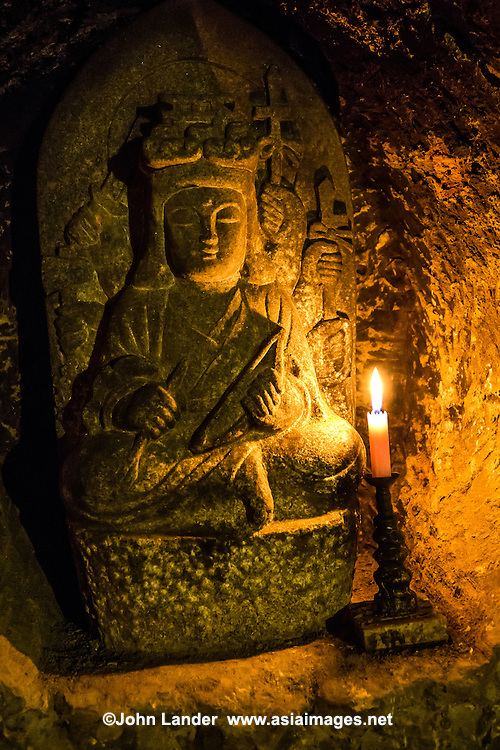 Benten-kutsu Cave is often overlooked by visitors to Hase-dera, but the inside is worthwhile for its ancient statues with lighted candles at their base. Benten is a Shinto deity and a perfect example of how Buddhism and Shinto are often intertwined in Japan as Benten-Kutsu Cave is within Hase-dera temple grounds. Benten-kutsu Cave is where Benzaiten and 16 children are chiseled out of the rock walls. Benzaiten is a sea goddess among the Seven Lucky Gods of Japan. Her temples and shrines are always located near water - rivers, oceans, ponds. She is the patron of music, the fine arts, and good fortune in general, and usually carries a biwa or Japanese lute.