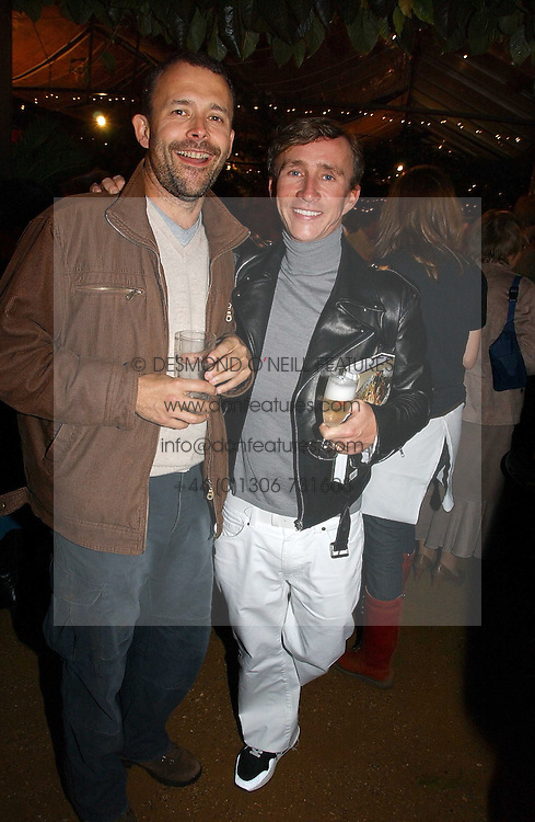 Left to right, actor HARRY BURTON and JASPER CONRAN  at a party to celebrate the publication on 'A Year in My Kitchen' by Skye Gyngell held at The Petersham Nurseries, Petesham, Surrey on 19th October 2006.<br /><br />NON EXCLUSIVE - WORLD RIGHTS
