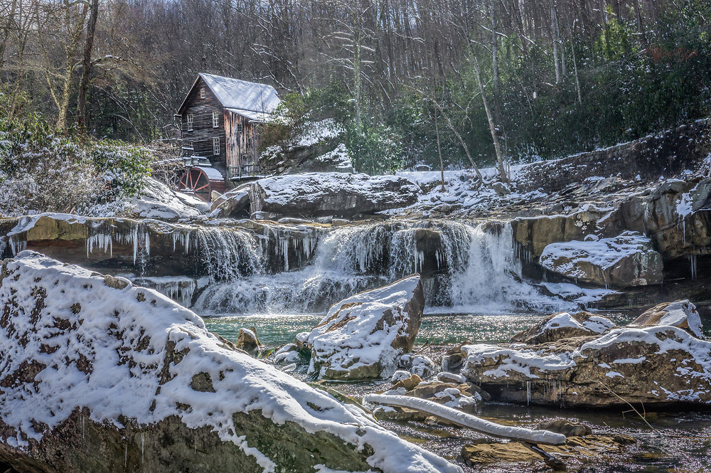 A fresh coat of ice and snow marks the end of winter around the old grist mill at Babcock State Park in West Virginia.