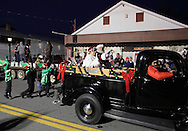 Pine Bush, New York  Santa Claus and Mrs. Claus wave to the crowd from the back of an antique truck during the parade down Main Street at the Community Country Christmas 2011 celebration on Dec. 3, 2011.