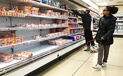© Licensed to London News Pictures. 04/10/2021. London, UK. A shopper looks at nearly empty shelves of frozen turkeys and meat products in Iceland, north London, amid fears of food shortages over Christmas. The Government and retailers warn that food and fuel shortages could continue until Christmas due to labour shortages following Brexit. According to Iceland, sales of frozen turkeys are up by more than 400 per cent compared to this time last year. Photo credit: Dinendra Haria/LNP