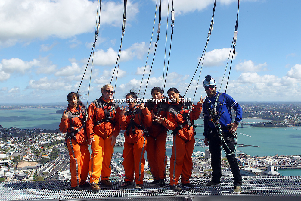 International Performer Lilly Singh (Superwoman) takes in the sights from the Sky Walk with 4 winners of a radio/newspaper competition. SkyWalk, Skytower, Auckland. 18 October 2013. Photo: William Booth/www.photosport.co.nz