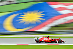 SEPANG, Sept. 29, 2017  Germany's Formula One driver Sebastian Vettel of Ferrari competes during the second practice session of the Formula One Malaysia Grand Prix at the Sepang Circuit in Malaysia, on Sept. 29, 2017. (Credit Image: © Chong Voon Chung/Xinhua via ZUMA Wire)