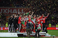 The Wales team and coaching staff/officials join in the celebrations after the match as the Wales team qualify for Euro 2016 finals in France.  Wales v Andorra, Euro 2016 qualifying match at the Cardiff city stadium  in Cardiff, South Wales  on Tuesday 13th October 2015. <br /> pic by  Andrew Orchard, Andrew Orchard sports photography.