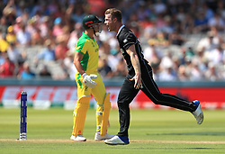 New Zealand's James Neesham (right) celebrates the wicket of Australia's Marcus Stoinis during the ICC Cricket World Cup group stage match at Lord's, London.