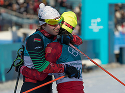 February 25, 2018 - Pyeongchang, South Korea - PyeongChang, South Korea - CHI CHUNXUE, right, of China hugs VALIANTSINA KAMINSKAYA of Belarus, the last finisher in Cross-Country Skiing: Ladies' 30km Mass Start Classic at Alpensia Cross-Country Skiing Centre. Kaminskaya was the last athlete to finish an event during the 2018 Pyeongchang Winter Olympic Games on February 25, 2018. (Credit Image: © Paul Kitagaki Jr. via ZUMA Wire)