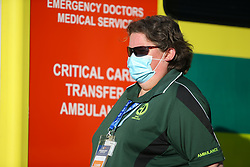 A paramedic is seen pitchside wearing a face mask - Mandatory by-line: Arron Gent/JMP - 18/06/2020 - FOOTBALL - JobServe Community Stadium - Colchester, England - Colchester United v Exeter City - Sky Bet League Two Play-off 1st Leg