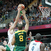 31 July 2012: Great Britain Joel Freeland goes for the layup in the traffic during 67-62 Team Brazil victory over Team Great Britain, during the men's basketball preliminary, at the Basketball Arena, in London, Great Britain.